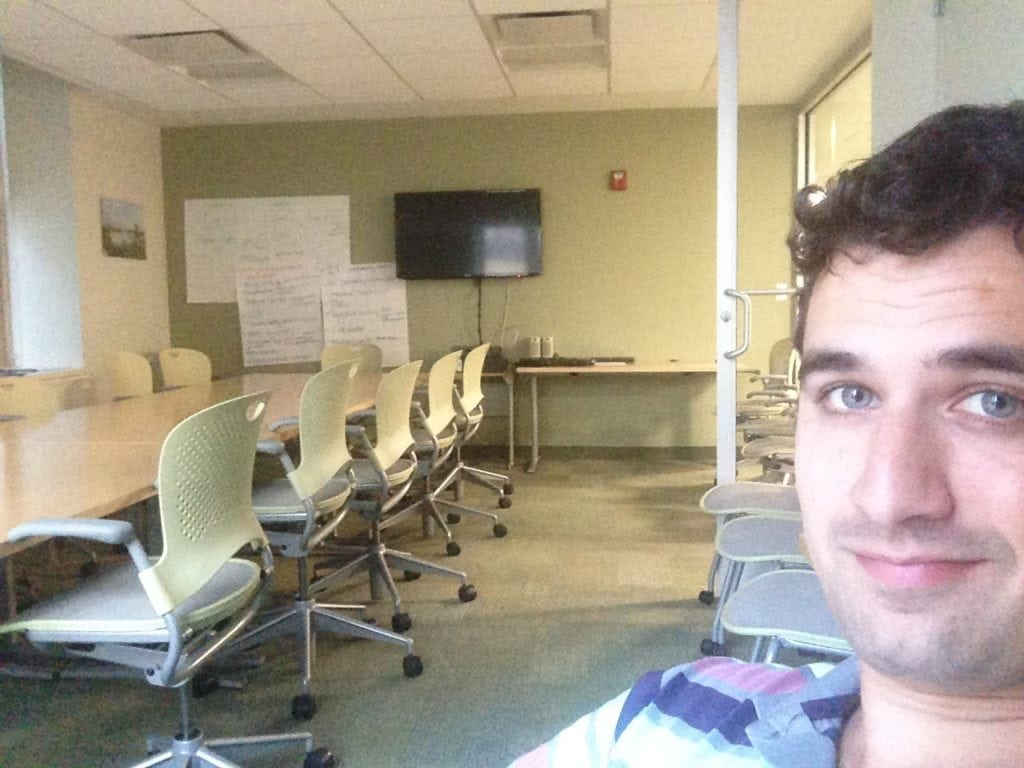 Taking my last phone in one of 1000s of empty conference rooms.